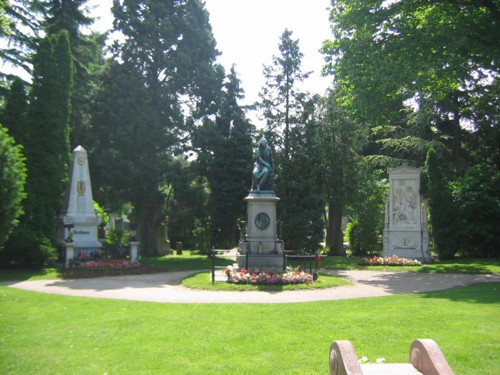 Beethoven on the left, Schubert on the right. They flank a monument to Mozart in the Central Cemetery of Vienna